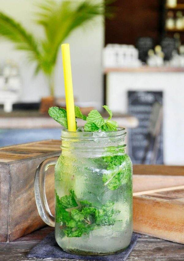 The perfect mojito served with lime and fresh mint in a mason jar.