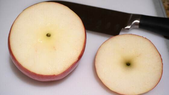 Apple sliced from the top by a Pampered Chef Santoku Knife