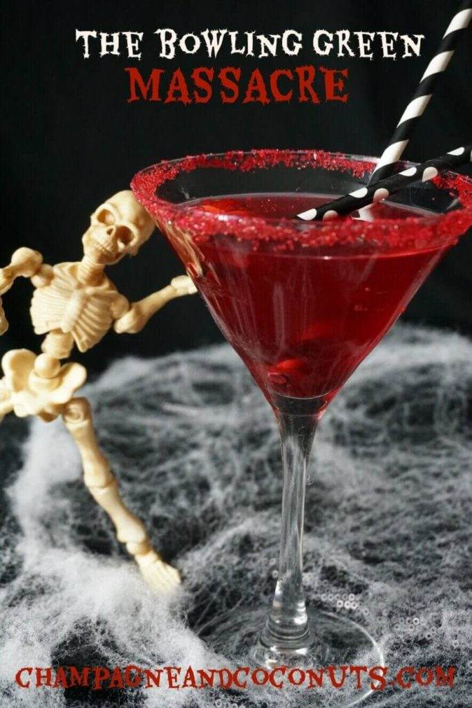 A posable skeleton with the cosmopolitan inspired Bowling Green Massacre Martini drink. Served in a red sugar rimmed martini glass with black and white paper straws.