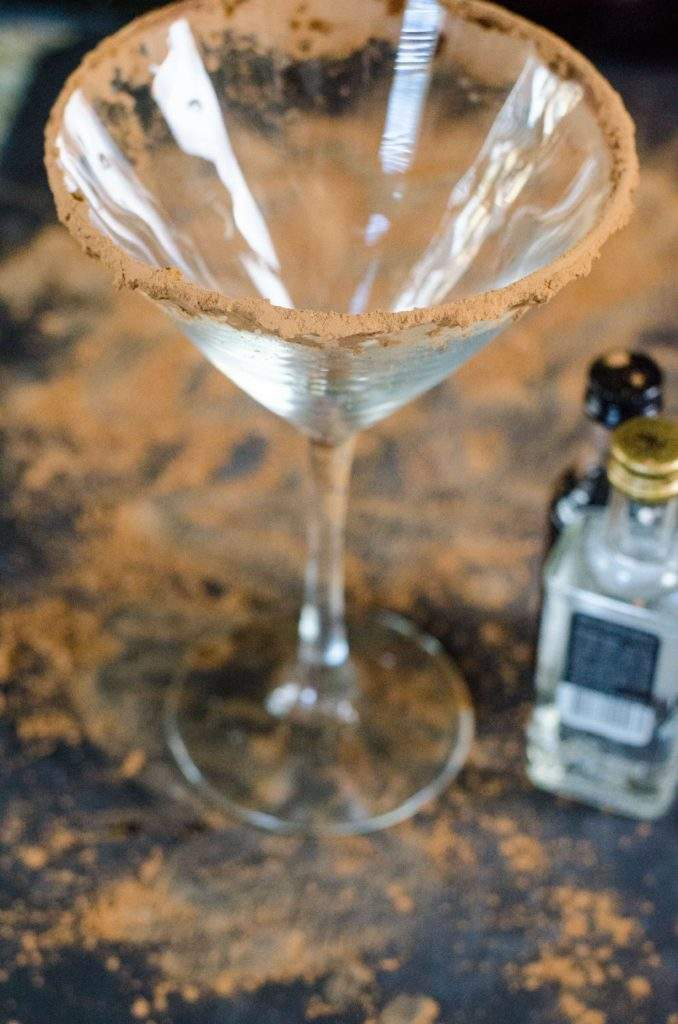 Martini glass rimmed with cocoa powder with vodka and creme de cacao