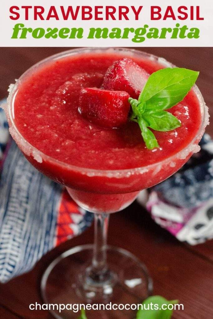A frozen drink garnished with fresh basil with a printed napkin. Text: Strawberry Basil Frozen Margarita