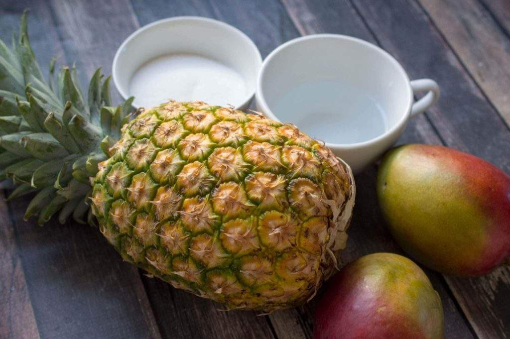 Pineapple with mangos and ingredients for simple syrup