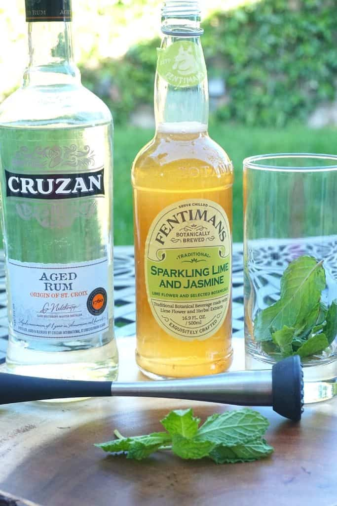 Ingredients to make a lime mojito with Fentiman's sparkling Jasmine and rum.