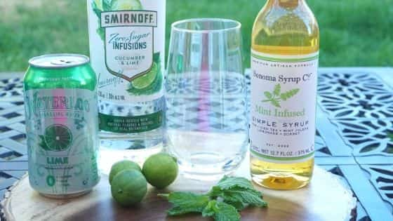 Ingredients to make a Cucumber Lime Vodka Collins.