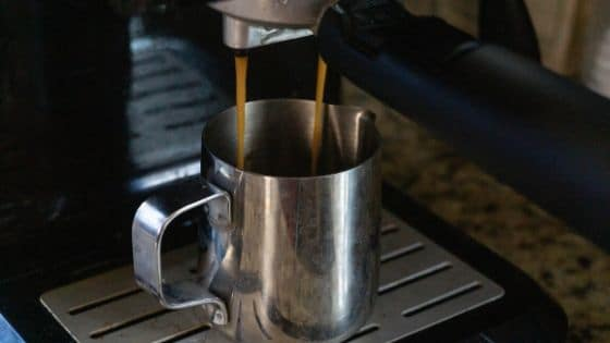 Brewing espresso with an espresso maker.
